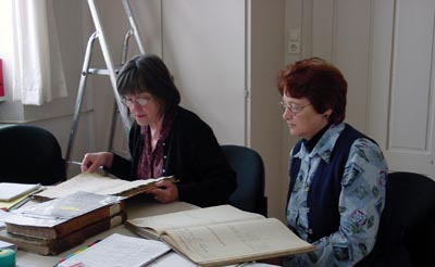 Nancy and Pat working through church book in Neckarelz